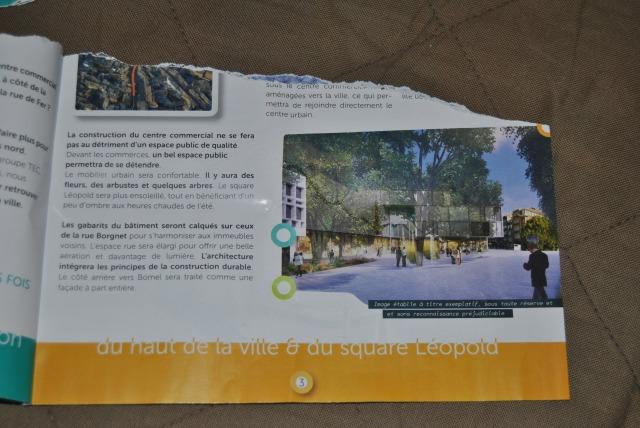 Une idéalisation de la future surface commerciale toute de verre... avec à l'avant plan les arbres qui auront été préalablement coupés ... Le pouvoir du greenwashing !